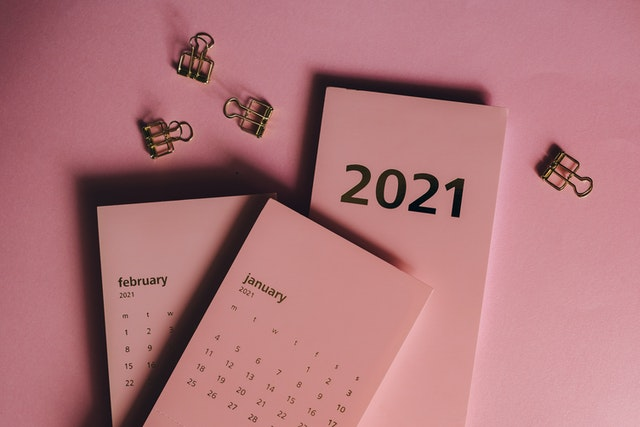2021 January and February calendar on a pink surface